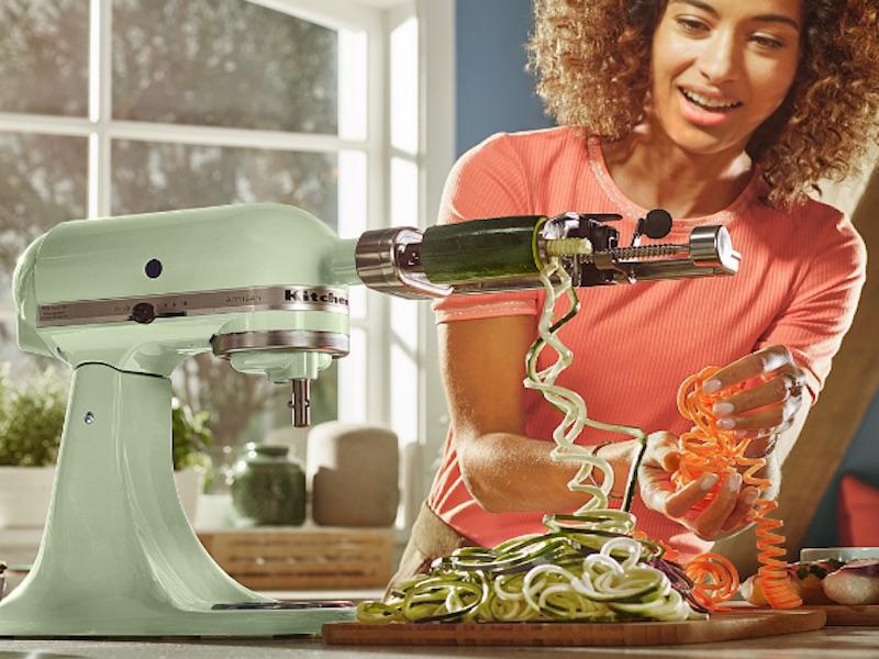 light green mixer spiralizing courgettes.'